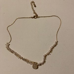 Light pink beaded necklace on a metal chain